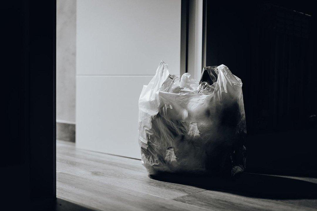 Plastics bags at base of door