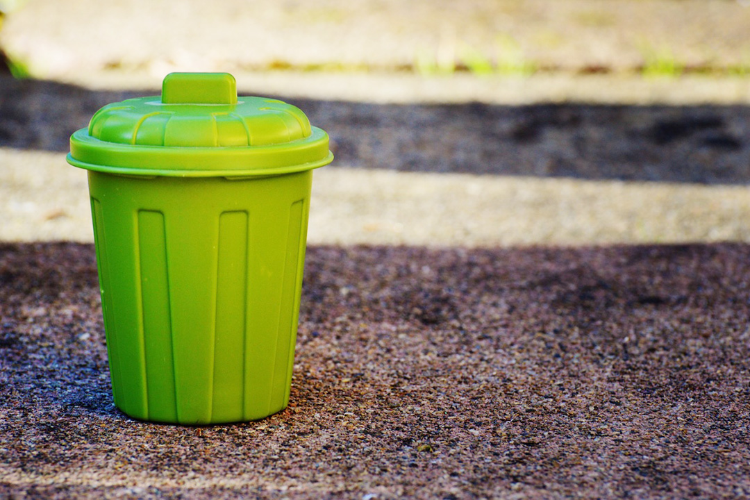 Green plastic waste management bin